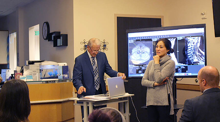 image of Dr. Fong and Dr. McIff presenting information to the Cognitive FX therapists and trainers