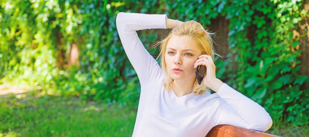 Image of a women talking on her phone looking confused