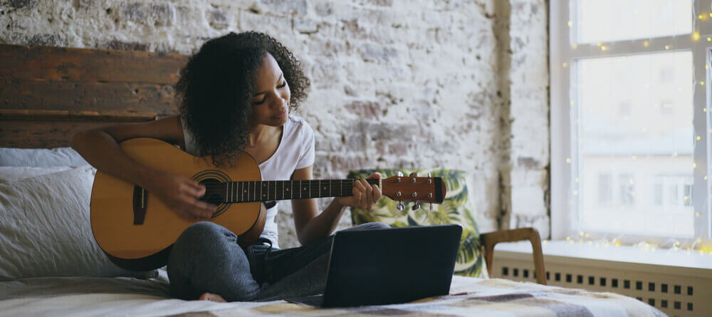 Image of a women playing a guitar