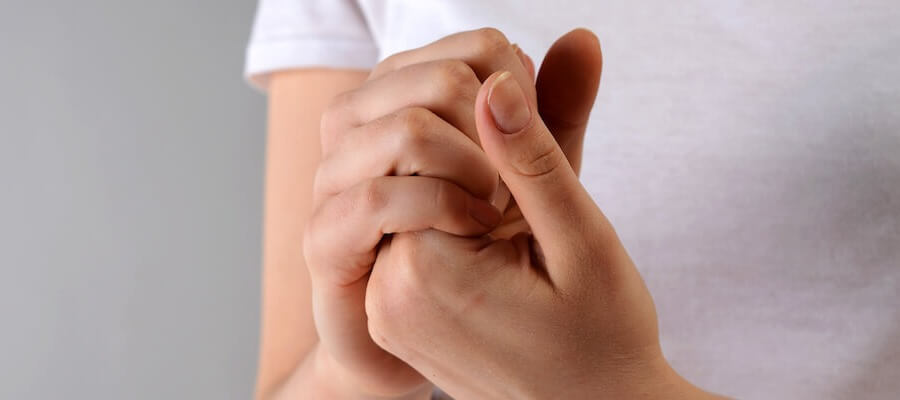 Holding hands to test for feeling in fingers