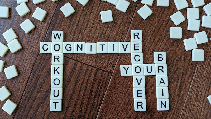 Scrabble letters spelling: Cognitive, Workout, Recover, Your, Brain