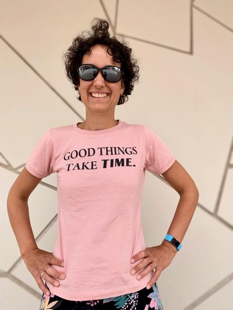 "Myrthe took treatment very seriously and it was well worth it! Myrthe pictured here wearing a pink shirt that reads: ""Good things take time."""