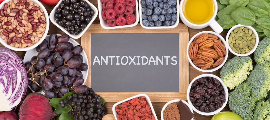Antioxidants: A photo shows grapes, blueberries, raspberries. nuts and misc veggies.