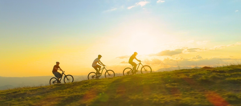 People riding their bikes during Golden Hour