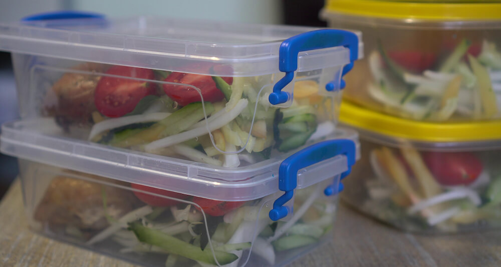 Premade salads in several containers.