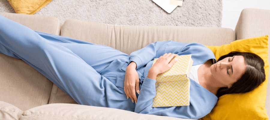 Women rests on couch with closed eyes