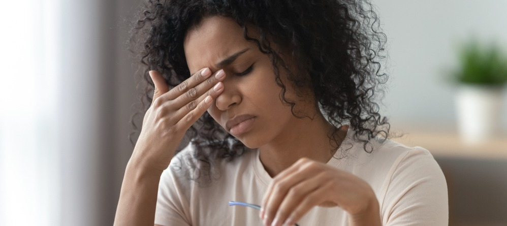 Women in pain from concussion strain