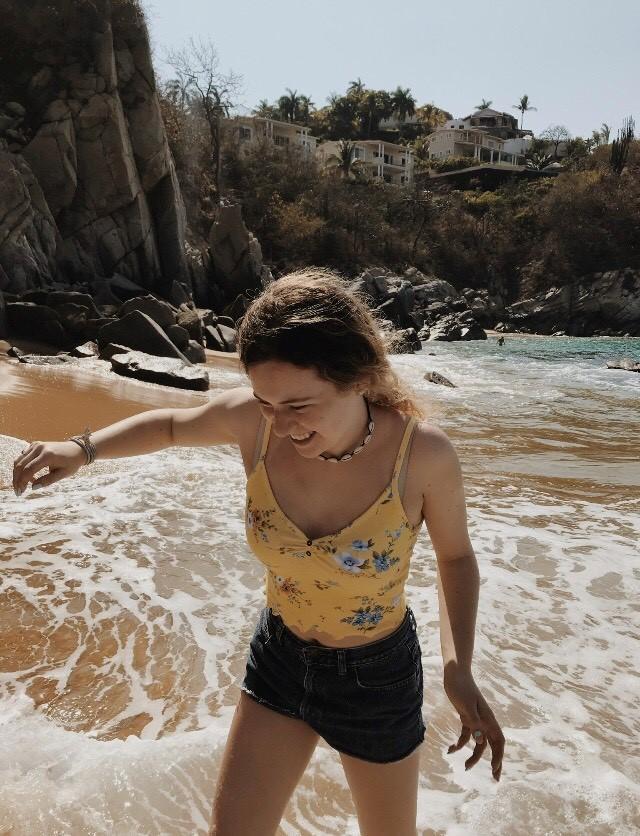A photo of Sam at the beach enjoying the sunshine.
