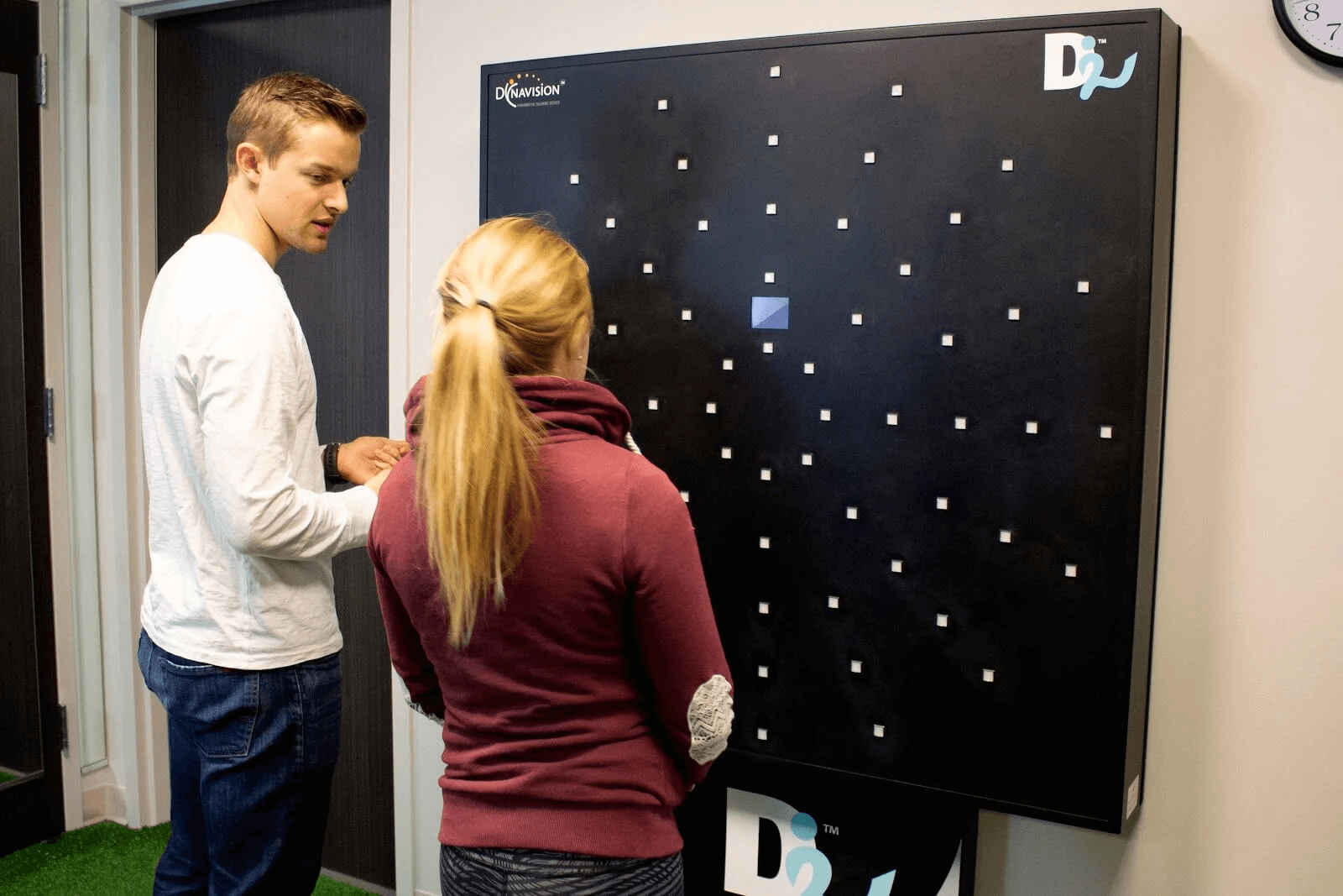 A patient is learning how to use the Dynavision board.