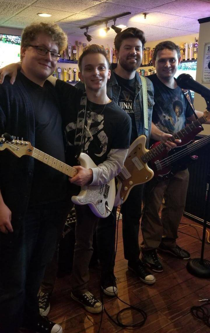 A photo of Chris and his band after the show.
